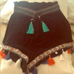 Black shorts with fringe stitching. Stretch waist